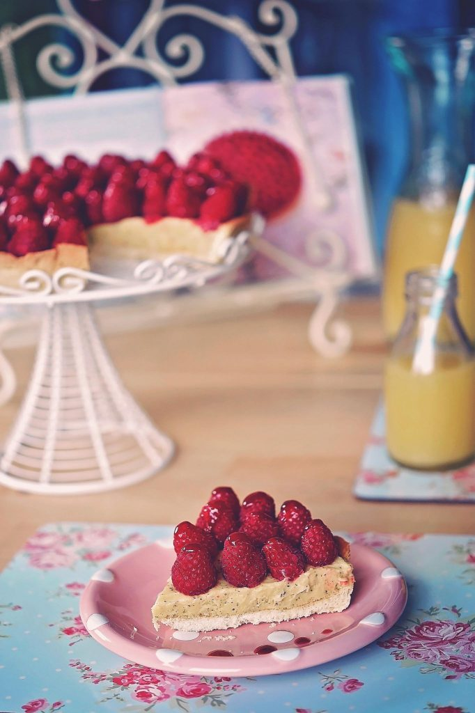 passion fruit tart with raspberries