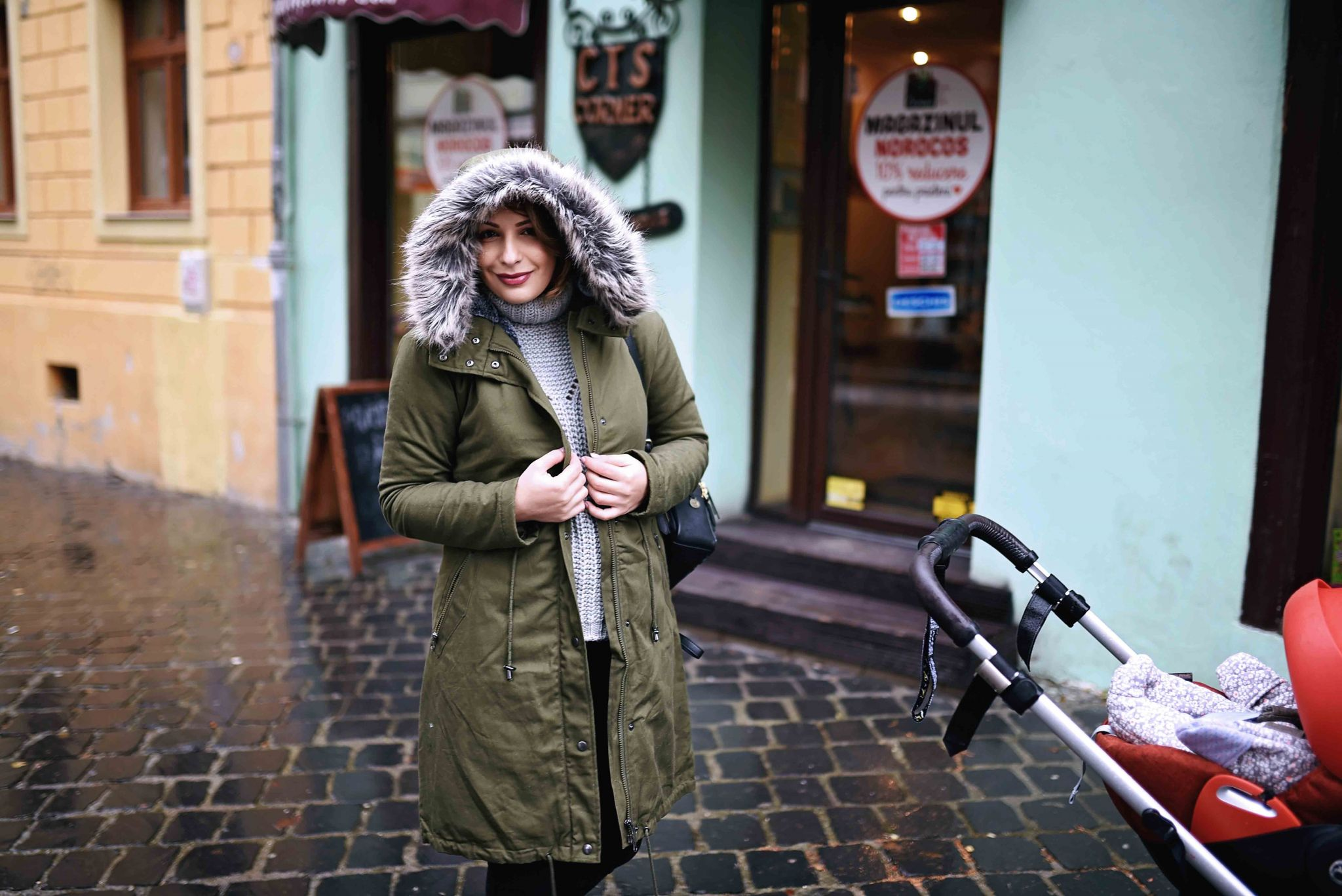 The parka of the season featuring babywearing –